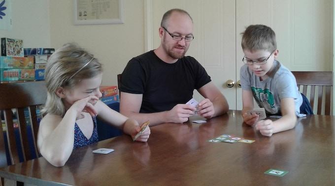 Game designer Norbert Abel plays Flaming Pyramids with his children