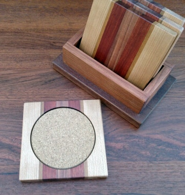 A coaster set, with complementary holder as well. Your set will be in the woods that you approve.