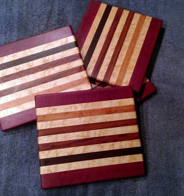 """Cheese boards are approximately 8"""" x 11"""" x 5/8"""". They have non-skid rubber feet held on with stainless steel screws, for long life. You will choose the woods used in your Cheese Board."""