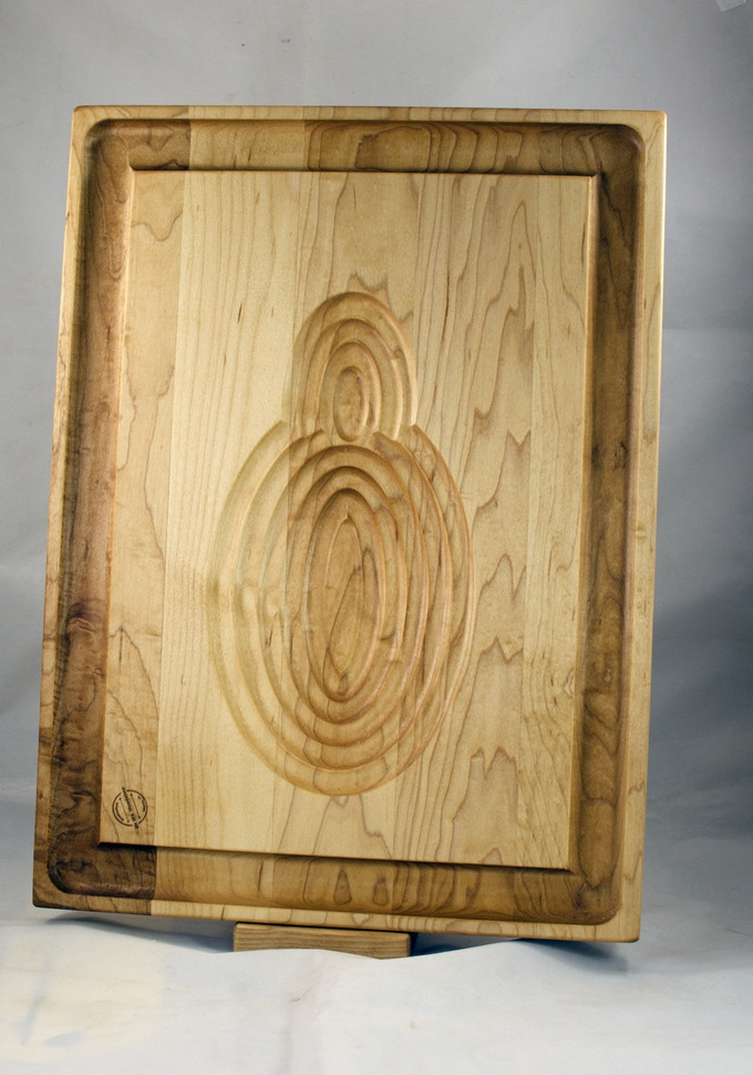 """The Carnivore Board. All Hard Maple, 14"""" x 18"""" x 1-1/4"""" thick. Shown here is the poultry side; the grooves hold the chicken or turkey in place while you carve."""