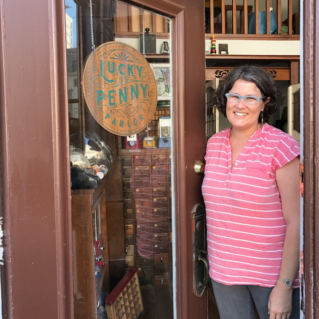 Lea greeting visitors to Lucky Penny Parlor in Downtown Oakland.