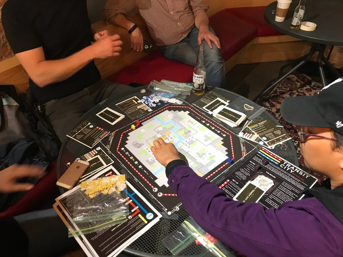The game being played here is a prototype; the final version will come with die-cut tiles and higher production values.