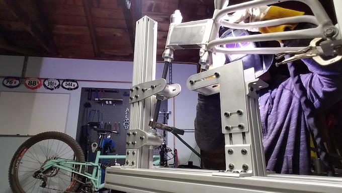 Erik welding a prototype frame in his versatile fixture.