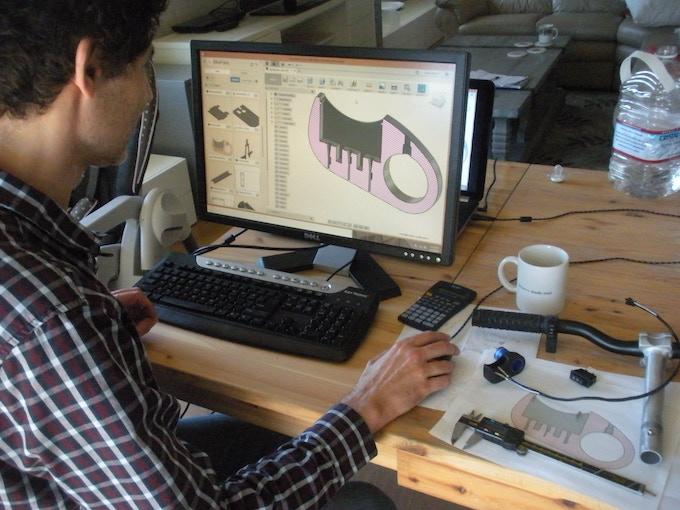 Nikolai preparing the speed switch cradle for 3D printing.