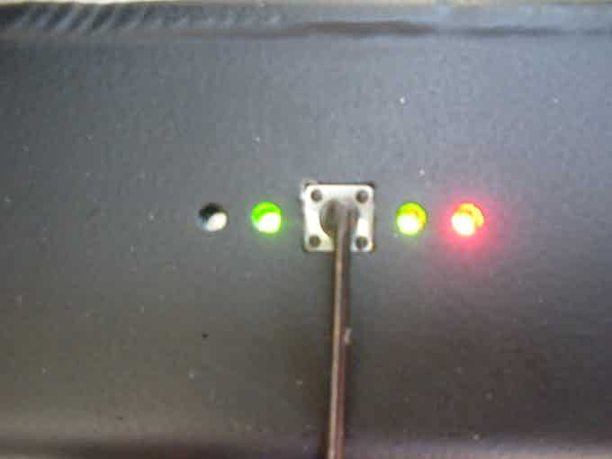 LED lights indicate level of battery charge when central button is depressed.
