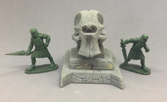 The Shrine of the Cyclops, sculpted by Dave Cauley, next to two of the cult guards.