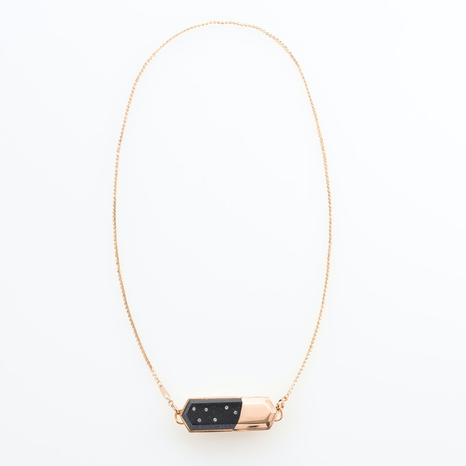 Blue Goldstone charm on rose gold-plated necklace