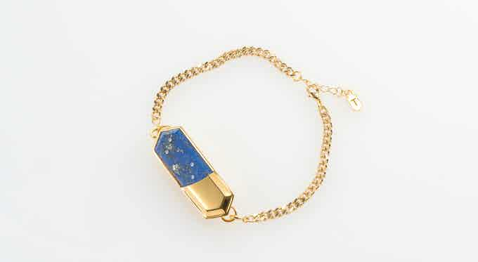 Lapis Lazuli charm on gold-plated chain bracelet