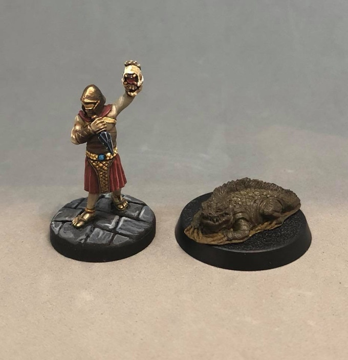 Gob Daw, irritable pet & guard lizard.  Sculpted by Dave Cauley!
