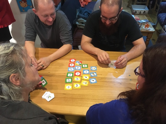 Dan (upper left) enjoys a game at Cakes n Ladders, Auckland.