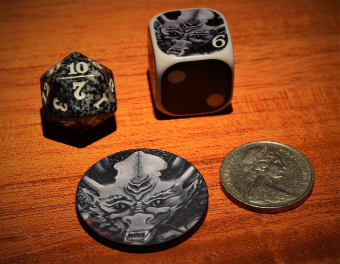 Dragon Token and Dice Sample Pic (Side by side comparison with a 20 sided dice and a 20 Cent Piece)
