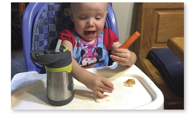 My youngest Julia, giving some carrots a ranch bath.