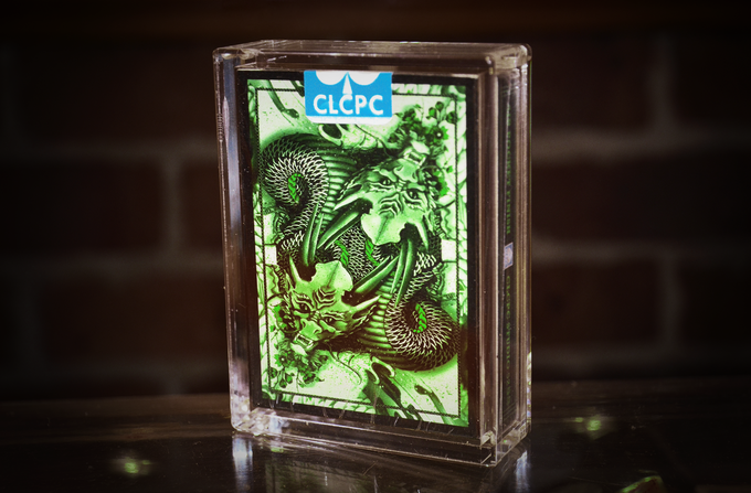 Product sample of Green Dragon Deck in clear acryillic display casing
