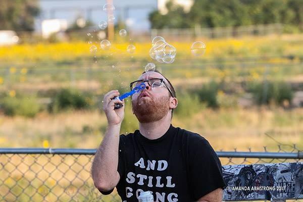 Kelly Shortandqueer blows bubbles as Kid 2 on the set of Camp Crash.  Photo credit Amanda Armstrong