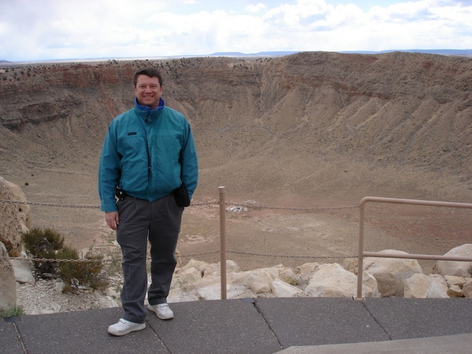 Dr. Bruce Betts seeing first hand what an asteroid can do to the surface of the earth. Here he is at Meteor Crater in Arizona during the 2013 Planetary Defense Conference.