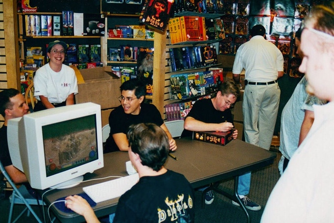 From left to right: Matt Uelmen, Karin Colenzo (back), Joe Morrissey (seated at PC), Rick Seis, and David Brevik sign copies of Diablo II at Hillsdale Mall in San Mateo. (Photo courtesy of Karin Colenzo-Seis.)
