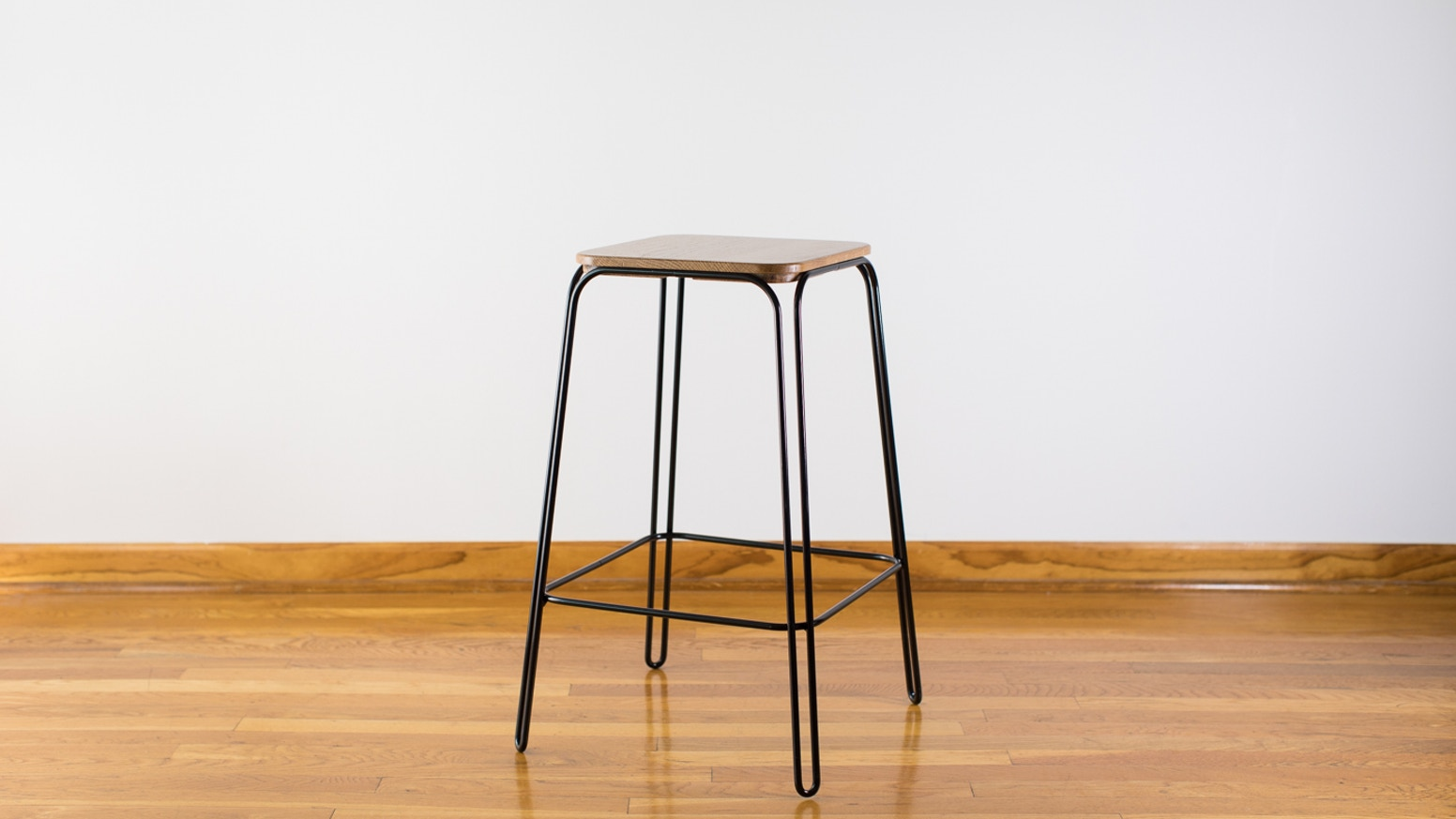 A modern take on the hairpin leg stool—made in the USA with a combination of computer-controlled-machines and hand-craft