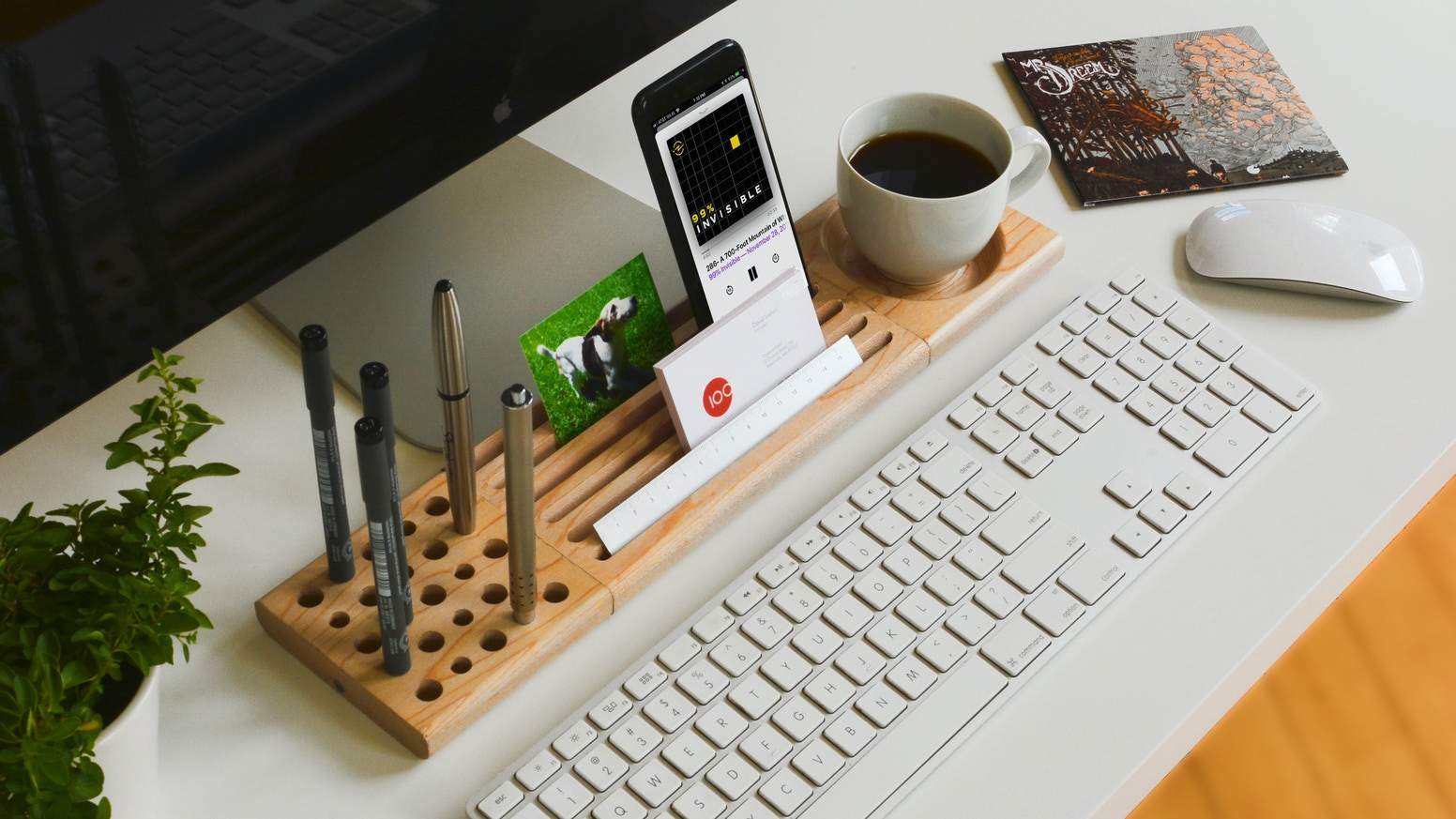 A simple, customizable, magnetically-connected organization system for home or office, crafted from solid Walnut & Maple
