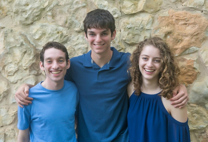 Louis (left) is a senior at Stanford University, and Rebecca (right) is a senior at Northeastern University. Joshua (middle) is a junior in high school; he is five years younger and almost a full foot taller.