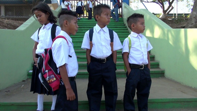the 4 Lopez children attending school for the first time