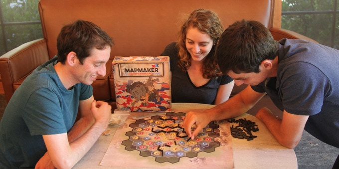 The 3 Lafair siblings playing a game of Mapmaker.