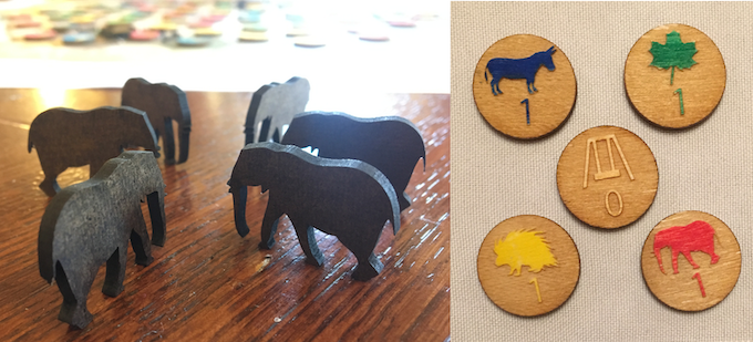 """Left: wooden elephant meeples. Right: the 5 swing counties, including 1 neutral swing county (depicting a """"swing"""")."""