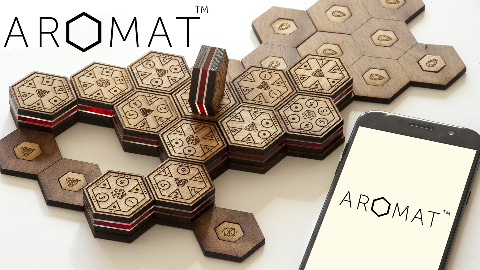 Luxuriously engraved wooden board game + app with highly aesthetic design, deep strategic possibilities & a huge variety in gameplay