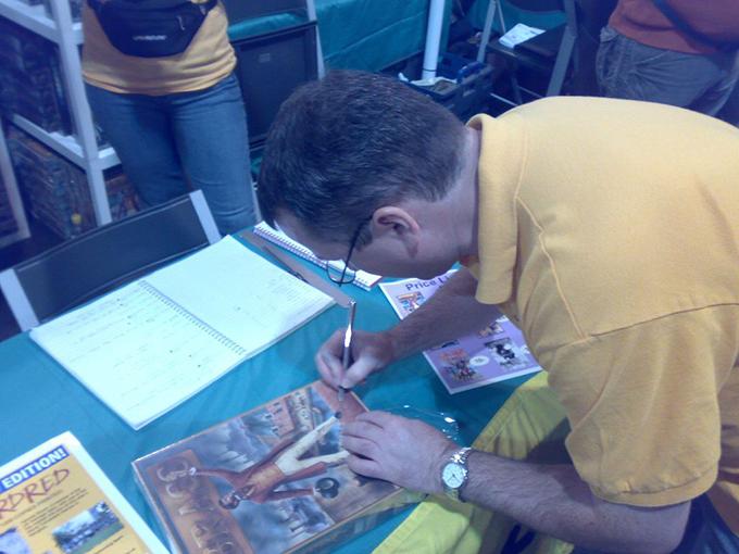 Martin signing Brass at Essen Spiel. Photo: Skiboy on BoardGameGeek.