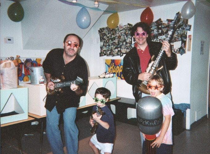 Carl and his son, Ben, rocking out. Ben actually became an accomplished drummer; Carl still plays an inflatable guitar.