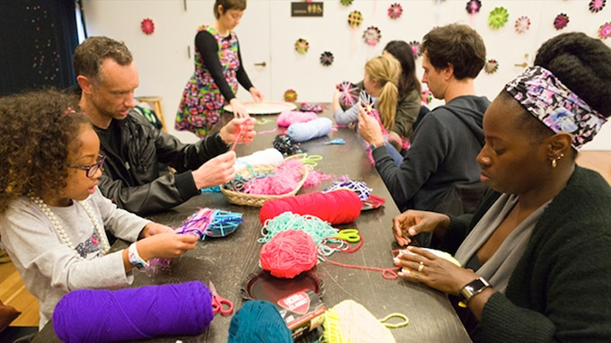 Participants weaving at de Young Museum during Angie Wilson's Artist Residency, December 2017. Photo: Kija Lucas