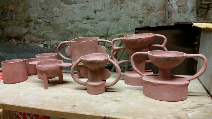 bisqued stoneware trophy-style vessels, ready for glazing