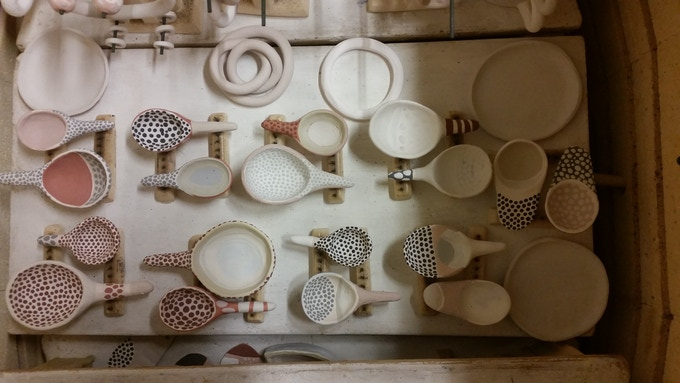 glazed sugar spoons, loaded into the kiln and suspended from the shelf to avoid fusing