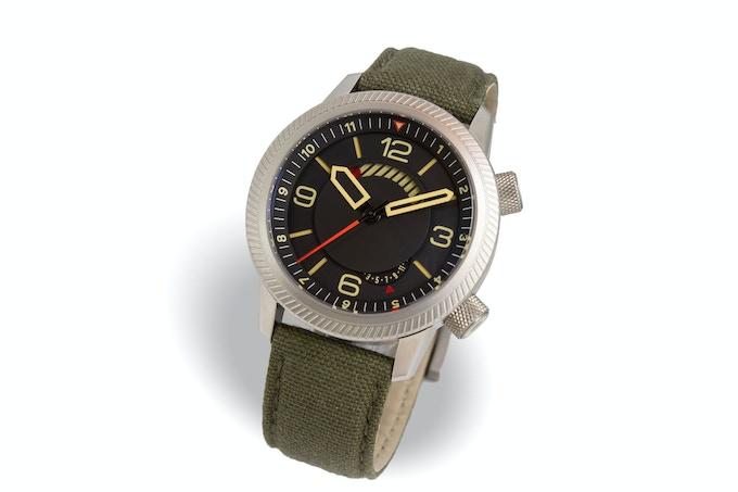 Steel case, black dial, green strap