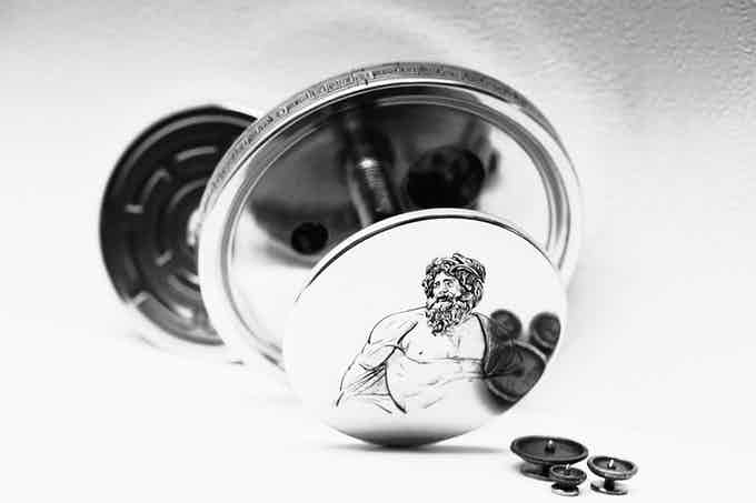 God Zeus in antique style etched on each box.