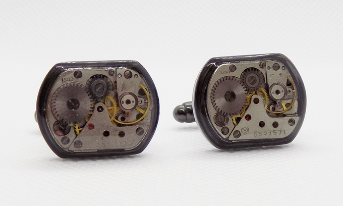 Small rectangular watch movements with a protective epoxy layer in black