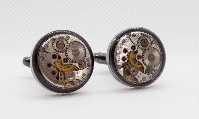 Round watch movements with a protective epoxy layer in black