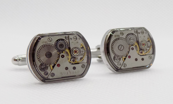 Small rectangular watch movements with a protective epoxy layer in silver