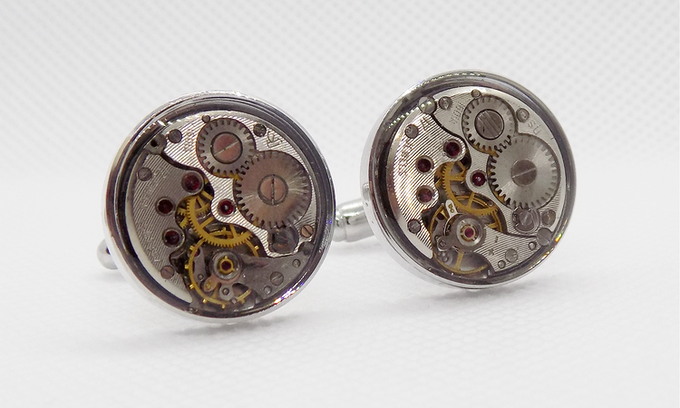 Round watch movements with a protective epoxy layer in silver