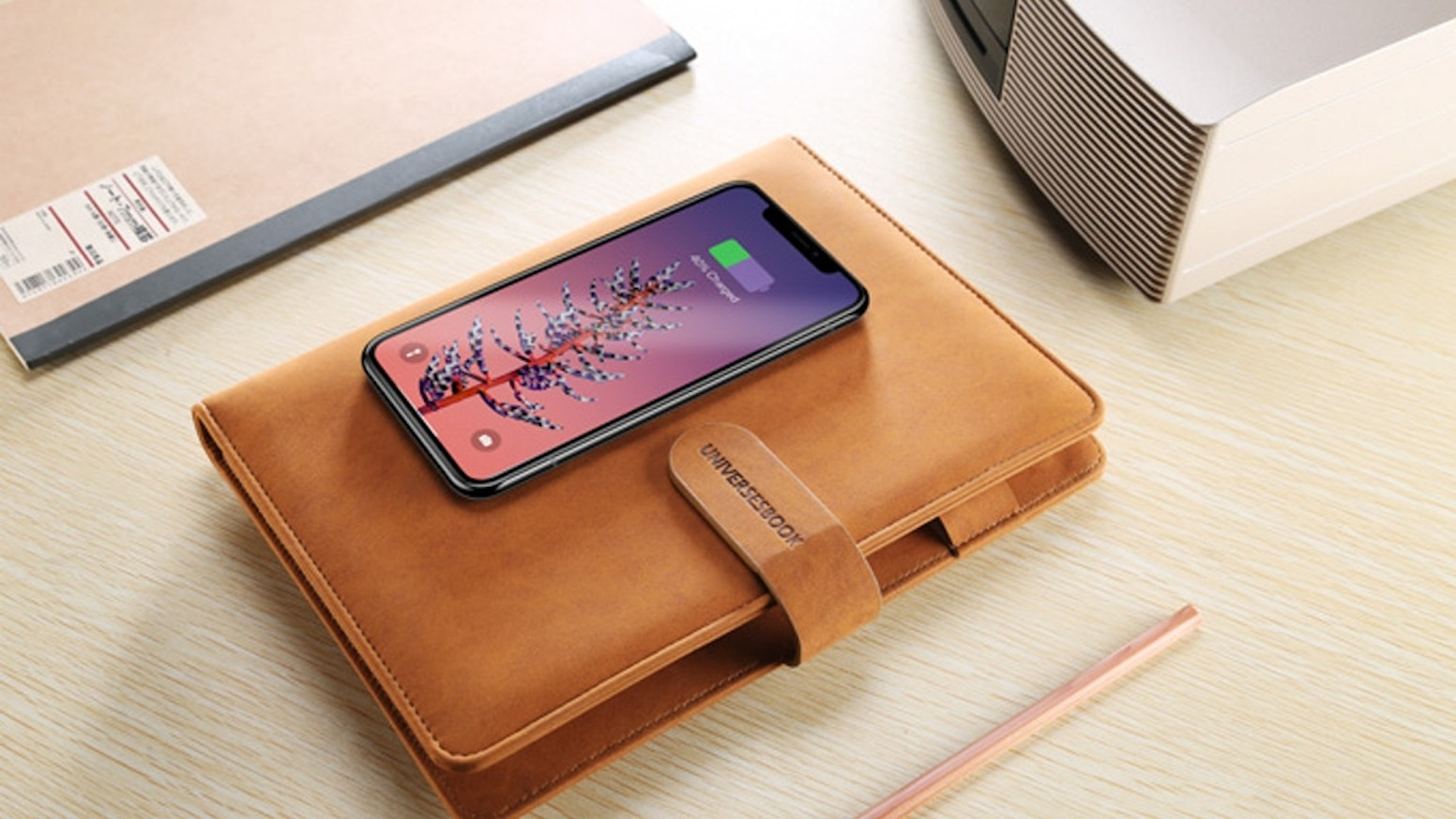 The Tesmo Universe Book is the world's most functional yet stylish multi-device charger and planner to simplify your life.