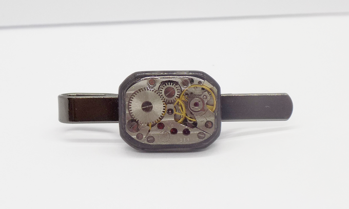 Tie bar in black with large rectangular watch movement with an epoxy protective layer