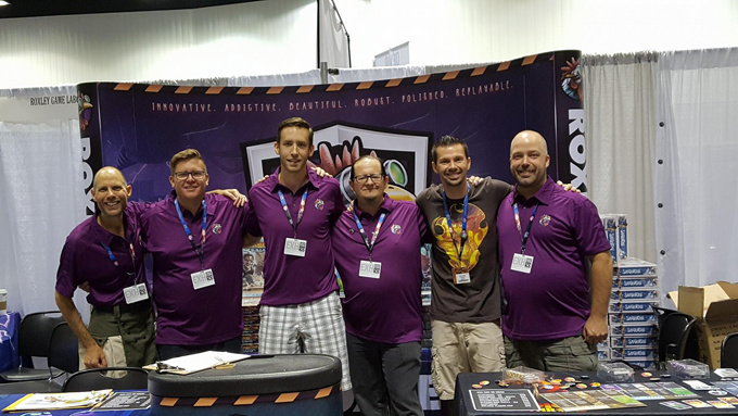 Team Roxley at Gen Con in 2017... strange how we each lined up under the word that describes us best.