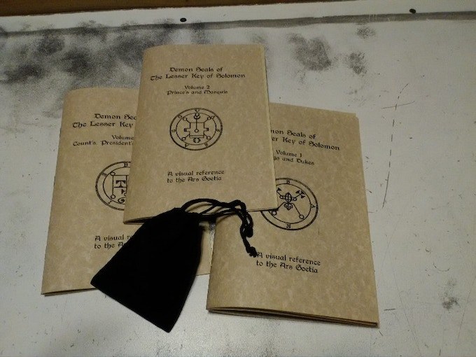 Booklets and velvet carrying pouch