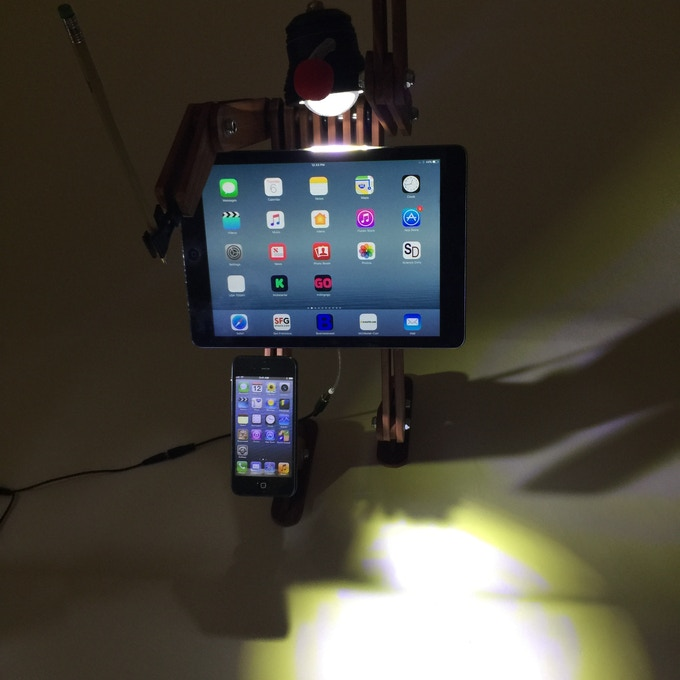 LumiMan holding smartphone and tablet