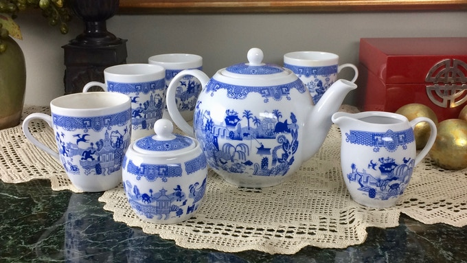Everything you need for a tea party—teapot, creamer and sugar set, and a set of the four original Things-Could-Be-Worse Mugs.