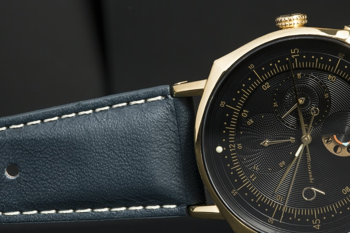 Detail shot showing the engraved intersecting lines of the dial