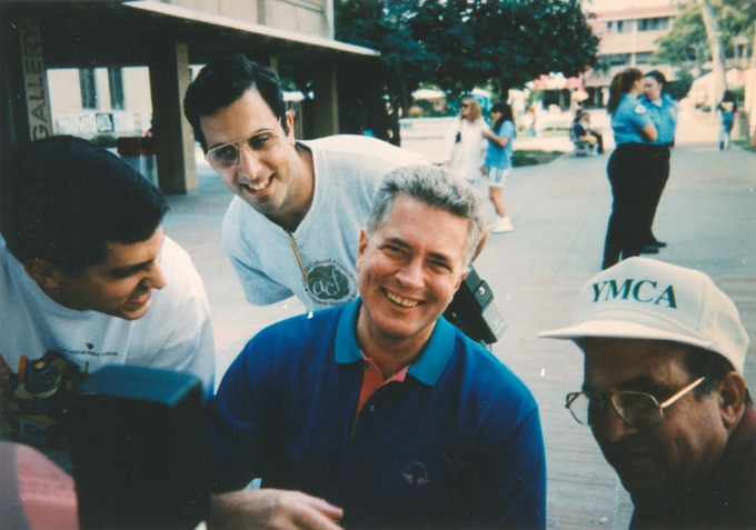 Huell with Vahan, Ara and Khechig Manoogian in 1990.