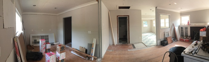 Future bar/order counter on the left, seating areas on the right.