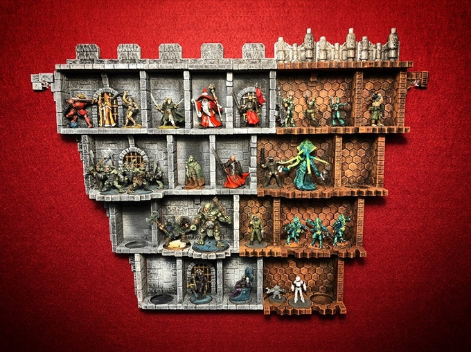 Fantasy and sci-fi themed shelves arranged with Reaper miniatures.