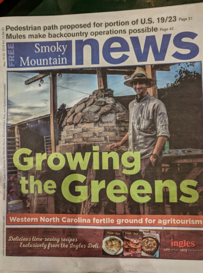 Chef Matt and our wood fired pizza oven on the cover of Smoky Mountain News. We were featured in an article about agritourism.