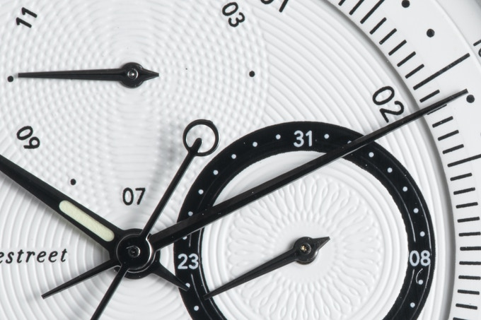 The Novem dial showcases a wealth of intersecting engraved Guilloche lines.